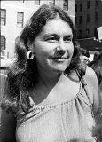 Vintage photo of Karen DeCrow smiling.